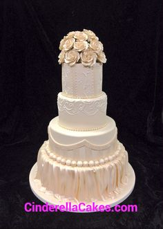 An all fondant wedding cake with gumpaste roses as the finishing touch
