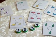 Milk Jug Lids- Number or Letter activities can easily be created with Shannon's Tot School printables! I have the lids made for numbers and alphabet, but have not printed any cards to go with them.