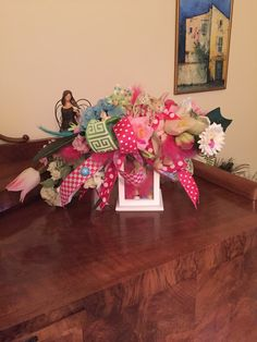 A spring lantern decor. Made out ot spring flowers, bunnies, butterflies, feathers and a small propeller. And funky bow.  More at https://www.facebook.com/Moje-vence-995508700482994/ Want something for yourself? Just contact me.