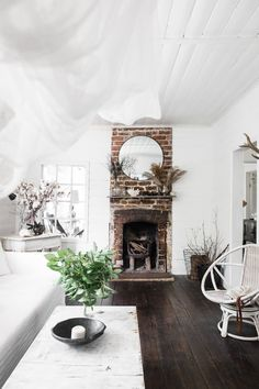 This country style fireplace with exposed brick and white walls behind makes this home feel warm and cosy Rustic Fireplaces, House Design, Cottage, Dream Decor, Best Interior, Holiday Cottage, Lounge Room, Home Buying, Fireplace