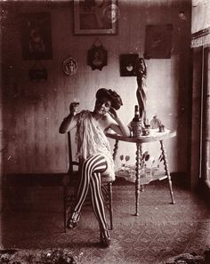 A woman in striped stockings in New Orleans's Storyville red light district