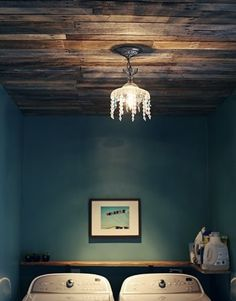 The wood ceiling. The wall color. The chandelier. Love.