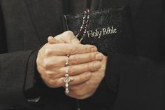 """Why Can't Women Be Priests in the Catholic Church?: A Catholic priest holds a Bible and <a href=""""http://catholicism.about.com/od/prayers/ht/Pray_the_Rosary.htm"""">rosary</a> in prayer."""