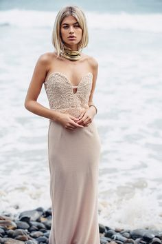 The magnificent Anaiya Dress is both alluring and flattering. Made in a blush hue, the strapless bodice is made from delicate lace with a contrast nude lining and features a plunge dip bust line, low back and textured fabric on skirt of dress. Wear with silver or  gold jewellery and a low wavy pony. Exclusively designed by Sabo Skirt for SABO FORMAL.