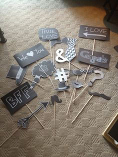 create your own photo booth signs with some black bristol board and white marker - could use gold or silver as well. tape to small doweling #photobooth #props #diy
