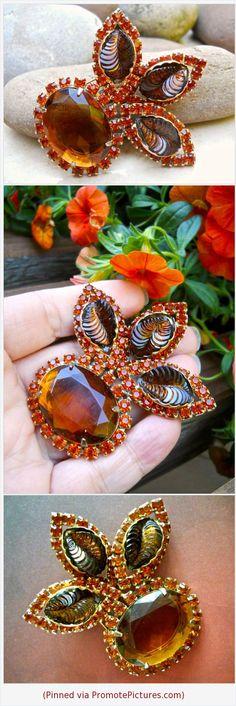 Carved Glass Topaz Amber Brooch, CATHE', Orange Rhinestones, Vintage #brooch #cathe #carvedglass #amberglass #topaz #rhinestones #vintage #floral https://www.etsy.com/RenaissanceFair/listing/570063802/carved-glass-topaz-amber-brooch-cathe?ref=listings_manager_grid  (Pinned using https://PromotePictures.com)