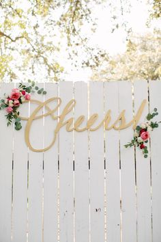 gold laser-cut Cheers! sign | The Nichols