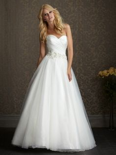 A soft and romantic ball gown. This design features an asymmetrically ruched strapless bodice with a sweetheart neckline and natural waistline defined with embroidery and crystals.