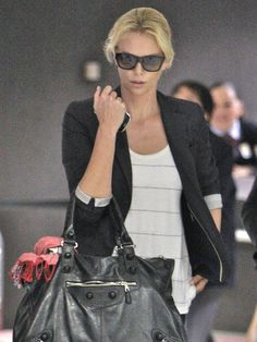 Charlize Thereon. Girl Crush! Casual style but so fashionable.