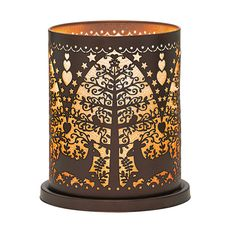 Adore PartyLite's new Woodland Deer Votive Hurricane! Traditional Scandinavian folk designs adorn our photo-etched metal holder.