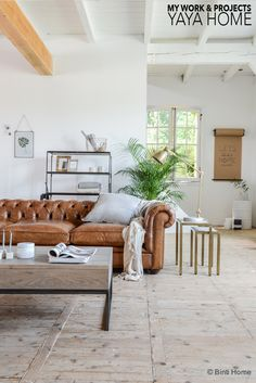 Cognac chesterfield sofa styled with the brass trend