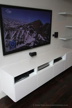Fitted floating media unit with wall mounted tv and floating shelves. Media Storage Unit, Media Unit, Entertainment Center Kitchen, Entertainment Center Decor, Tv Unit Images, Diy Kids Kitchen, House Deck, Wall Mounted Tv, Tv Cabinets