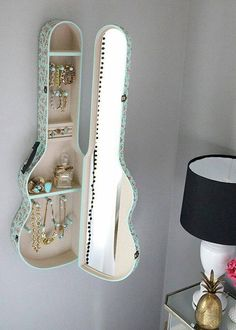 Guitar case jewelry holder