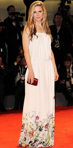 Look of the Day › August 31, 2012 Brit Marling WHAT SHE WORE The actress walked the red carpet at the Venice Film Festival in a floral Gucci column and burgundy clutch