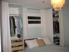 Simple cabinets placed on each side of the bed add clothing storage space. With the curtains closed, it actually looks nice with all that softness around the bed.