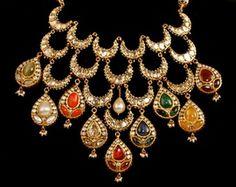 Indian Wedding Jewelry - Navratna Haar | WedMeGood Gold Bridal Necklace with nine different gems, also called navratna haar #wedmegood #jewelry #necklace #gold #navratna
