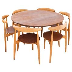 Danish Modern Set a Round Table and Six Chairs by Hans Wegner for Fritz Hansen | From a unique collection of antique and modern dining room sets at https://www.1stdibs.com/furniture/tables/dining-room-sets/