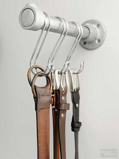 Industrial fittings for hanging clothing and accessories give one side of the closet a masculine edge. By creating a defined space for often-worn belts, its easy to streamline the get-ready routine. Walking Closet, Wardrobe Closet, Closet Space, The Closet, Closet Tour, Closet Storage, Closet Organization, Organization Ideas, Belt Storage