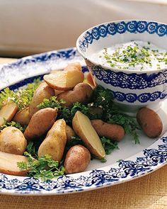 Fingerling Potatoes and Goat Cheese Fondue | Goat cheese and nonfat buttermilk make a light, tangy fondue. Fresh chives, thyme, tarragon, and parsley are a refreshing, colorful addition. If you do not own a fondue pot, a small slow cooker is an excellent way to keep this appetizer warm throughout the party.