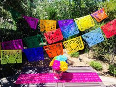 I could possibly mimic this idea with paper doilies (spray painted) and string..... Papel Picado banner 18 feet long colorful paper or by MesaChic