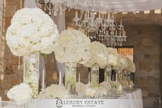 Beautiful white tall and short centerpieces with chandelier | Wedding Planning & Design by Luxury Estate Weddings & Events | luxuryestateweddings.com
