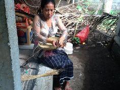 A master weaver in Tenganan making a traditional ata grass basket.