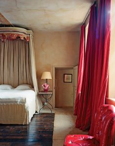 House tour: a English estate gets a pared-back makeover: An French bed covered with antique linen in the grand main bedroom of the cottage, within the surrounds of the main house. The red leather chair is from Howe Antiques in London. Master Bedroom, Bedroom Decor, Bedroom Red, Bedroom Ideas, Royal Bedroom, Bedroom Inspo, Neoclassical Interior, Neoclassical Design, French Bed