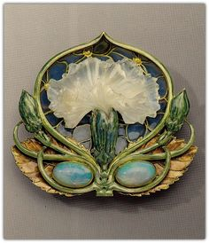 RENÉ LALIQUE | 'Carnation' brooch. Gold, enamel, opal, and moulded glass. Circa 1900-1902.