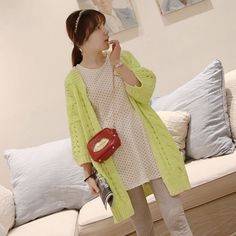 LONG SLEEVED KNITTED COAT