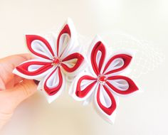 Two red and white lotus flowers in new and upcycled satin, on a comb, with a veil, made in the tsumami kanzashi technique