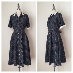 "VINTAGE | 1950s Floral Fit & Flare FEATURES:  *Short sleeves  *Contrasting collar & Cuffs  *Button front  *Obi belt with loops  *Flared skirt  *Polyester blend  MEASUREMENTS: Bust - 34"" Waist - 24 1/2"" (stretches) Hips - 44"" Length - 41 1/4""  ✅ Very good vintage condition ⛔️ NO SWAPS/TRADES/RESERVES Vintage Dresses"