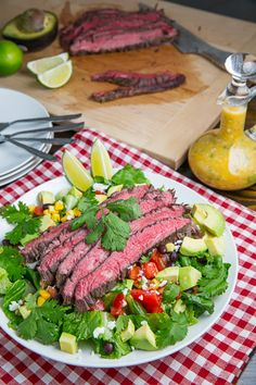 Carne Asada Salad with Sour Orange and Mojo Garlic Dressing with cumin, cilantro, lime, and jalapeños. A healthy salad with avocado, corn, black beans, and Tomato's.