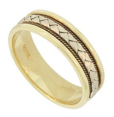 This mens 14K bi-color wedding band is decorated with multiple layers of yellow and white gold braiding. The edges of the wedding ring are wide and brightly polished. This elegant estate wedding band measures 6.04 mm in width. Circa: 1950. Size 9. We can re-size slightly.