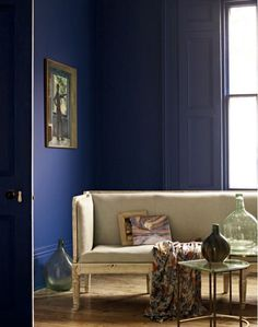 French/Scandinavian painted antique sofa, looking marvie reupholstered in linen and sitting in a cobalt blue room!