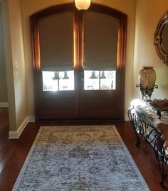 Custom blackout roman shades on arched front doors adds privacy to this elegant foyer. Front Door Curtains, Arched Front Door, Front Door Entryway, Front Doors With Windows, Arched Doors, Glass Front Door, Curtains With Blinds, Entryway Ideas, Entry Doors