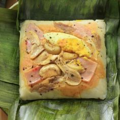 Filipino Tamales is made of ground rice, coconut milk and various toppings like chicken, ham, nuts and egg. Try this Kapampangan rice dish delicacy recipe. Filipino Dishes, Filipino Desserts, Filipino Recipes, Filipino Food, Filipino Tamales Recipe, Tikoy Recipe, Pork Hamonado Recipe, Steamed Pork Buns, Pork Belly Slices
