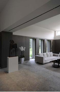 Minimalist modern interior, neutral tones and nice integrated lighting _