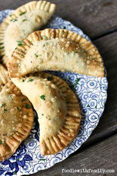 Shepherd's Pie Empanadas - Beef, gravy, corn, peas, and mashed potato stuffed in a flaky, golden brown crust!