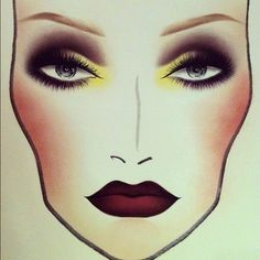 Smokey eyes with a pop of yellow, and dark lips. Gotta try this.