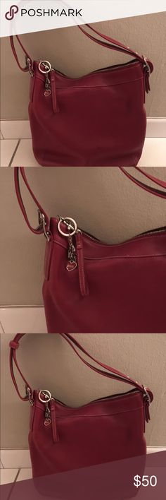 Coach Small Red Hobo Bag Small red hobo bag from Coach. Great condition. Cool vintage, classic look. Keychain is a little worn. Coach Bags Hobos