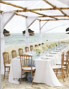 I love this informal and family-style approach to a beach wedding reception. Can't you just picture the bonfire off to the left later on?