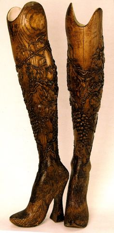 Hand-Carved Prosthetic Legs: Designed by Alexander McQueen. Made of Elm wood, decorated with delicately carved flowers,  originally worn on the runway by double-amputee model  athlete Aimee Mullins.