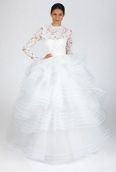 Brides.com: Wedding Dresses with Long Sleeves from the Bridal Runways. Lace ballgown, Oscar de la Renta  See more Oscar de la Renta wedding dresses.