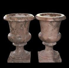 """Pair of large marble planters feature a smooth victorian style design. Each planter with a pedestal base, wide shoulders and open rim. CIRCA: 20th Ct. ORIGIN: France DIMENSIONS: H: 29.5"""" L: 21.5"""""""