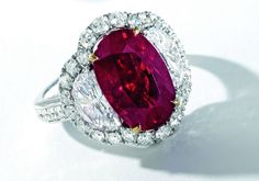 A Spectacular 7.03-carat Burmese Mogok Pigeon's Blood Ruby and Diamond Ring