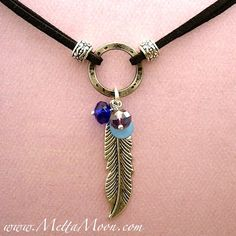 MettaMoon Silver Shine Feather & Crystal Necklace $20 Hand made fashion collection!  www.MettaMoon.com