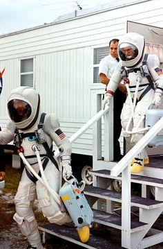Astronauts wearing lightweight pressure suits