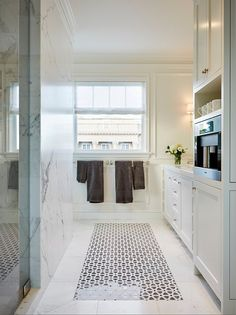 Built-In Espresso Station in white Master Bathroom