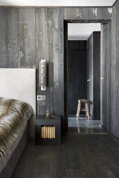 Dark stained timber walls and floors # chic masculine bedroom