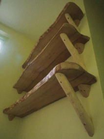 Shelves made from a combination of rough-sawn timber and tree branches.